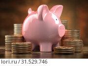 Купить «Piggy bank and Stacks of olden coins. Concept of finance, savings and investitions.», фото № 31529746, снято 22 июля 2019 г. (c) Maksym Yemelyanov / Фотобанк Лори
