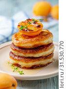 Купить «Pancakes with apricot jam and thyme for breakfast», фото № 31530770, снято 13 июля 2019 г. (c) Марина Сапрунова / Фотобанк Лори