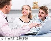 Купить «Mother and son signing documents», фото № 31530966, снято 28 марта 2017 г. (c) Яков Филимонов / Фотобанк Лори