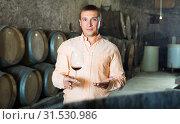 Купить «man with glass of wine in winery cellar», фото № 31530986, снято 22 сентября 2016 г. (c) Яков Филимонов / Фотобанк Лори