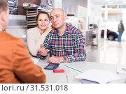 Купить «Couple discussing with a consultant a purchase», фото № 31531018, снято 4 апреля 2017 г. (c) Яков Филимонов / Фотобанк Лори