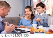Купить «Cheerful boy with mother listening to father with laptop», фото № 31531130, снято 8 апреля 2020 г. (c) Яков Филимонов / Фотобанк Лори