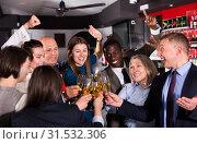 Купить «Colleagues clinking glasses of champagne on corporate party», фото № 31532306, снято 25 марта 2019 г. (c) Яков Филимонов / Фотобанк Лори