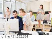 Купить «Professional start-up team working with pc and communicating», фото № 31532334, снято 1 августа 2018 г. (c) Яков Филимонов / Фотобанк Лори