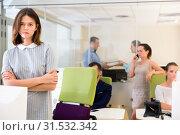 Купить «Portrait of frustrated young business woman in coworking space with working colleagues behind», фото № 31532342, снято 1 августа 2018 г. (c) Яков Филимонов / Фотобанк Лори