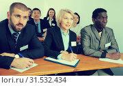 Купить «Group of employees listening to business training», фото № 31532434, снято 12 февраля 2018 г. (c) Яков Филимонов / Фотобанк Лори