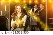 Jolly woman and her colleagues in laser tag room. Стоковое фото, фотограф Яков Филимонов / Фотобанк Лори