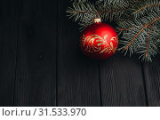 Купить «Christmas New Year decoration composition. Top view of fur-tree branches and balls frame on wooden background with place for your text.», фото № 31533970, снято 6 ноября 2018 г. (c) easy Fotostock / Фотобанк Лори