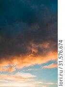 Купить «Небесный пейзаж. Sunset colorful sky background - orange and blue dramatic colorful clouds lit by evening sunshine. Sunset sky landscape», фото № 31576674, снято 21 ноября 2018 г. (c) Зезелина Марина / Фотобанк Лори