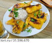 Купить «Roasted chicken wings with mustard sauce», фото № 31596670, снято 19 июля 2019 г. (c) Яков Филимонов / Фотобанк Лори