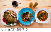Купить «Image of tasty cooked different dishes from lamb with greens and vegetables», фото № 31596710, снято 22 июля 2019 г. (c) Яков Филимонов / Фотобанк Лори