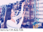 Купить «woman choosing fashionable riviere», фото № 31622726, снято 17 января 2018 г. (c) Яков Филимонов / Фотобанк Лори
