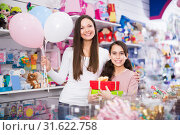 Купить «cheerful woman and daughter with gifts and balloons in the shop», фото № 31622758, снято 22 января 2018 г. (c) Яков Филимонов / Фотобанк Лори