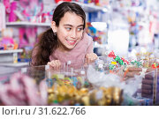 Купить «Emotional small girl choosing sweet candies in the candy shop», фото № 31622766, снято 22 января 2018 г. (c) Яков Филимонов / Фотобанк Лори