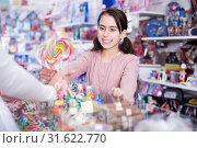 Купить «Girl buying candies from seller in the candy shop», фото № 31622770, снято 22 января 2018 г. (c) Яков Филимонов / Фотобанк Лори