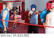 Купить «Teenage sportsman at boxing workout with coach», фото № 31623002, снято 12 апреля 2017 г. (c) Яков Филимонов / Фотобанк Лори