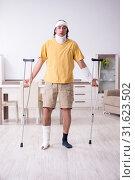 Купить «Young man after accident recovering at home», фото № 31623502, снято 3 мая 2019 г. (c) Elnur / Фотобанк Лори
