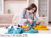 Купить «Young beautiful woman knitting at home», фото № 31624270, снято 19 февраля 2019 г. (c) Elnur / Фотобанк Лори