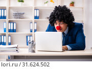 Купить «Young clown businessman working in the office», фото № 31624502, снято 14 декабря 2018 г. (c) Elnur / Фотобанк Лори