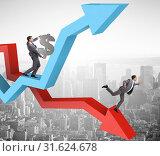 Businessman with charts of growth and decline. Стоковое фото, фотограф Elnur / Фотобанк Лори