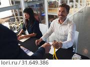 Купить «Male executive giving employee id to Businessman at conference registration table», фото № 31649386, снято 16 марта 2019 г. (c) Wavebreak Media / Фотобанк Лори