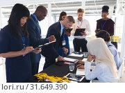 Купить «Business people checking in at conference registration table», фото № 31649390, снято 16 марта 2019 г. (c) Wavebreak Media / Фотобанк Лори