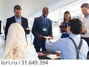 Купить «Business people checking in at conference registration table», фото № 31649394, снято 16 марта 2019 г. (c) Wavebreak Media / Фотобанк Лори
