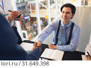 Купить «Business people shaking hands with each other while checking in at conference registration table », фото № 31649398, снято 16 марта 2019 г. (c) Wavebreak Media / Фотобанк Лори