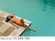 Купить «Woman relaxing at the edge of swimming pool», фото № 31649790, снято 19 марта 2019 г. (c) Wavebreak Media / Фотобанк Лори