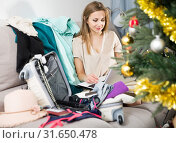 Купить «Woman with laptop planning Christmas holidays», фото № 31650478, снято 15 января 2019 г. (c) Яков Филимонов / Фотобанк Лори