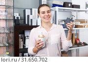 Купить «Woman choosing bottle for liquid soap for home in supermarket», фото № 31650702, снято 2 мая 2018 г. (c) Яков Филимонов / Фотобанк Лори