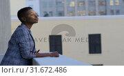 Купить «Businesswoman standing in balcony at office 4k», видеоролик № 31672486, снято 29 августа 2018 г. (c) Wavebreak Media / Фотобанк Лори