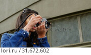 Купить «Woman clicking photo with digital camera in street 4k», видеоролик № 31672602, снято 23 августа 2018 г. (c) Wavebreak Media / Фотобанк Лори
