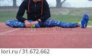 Купить «Front view of young Caucasian female athlete exercising on a running track 4k», видеоролик № 31672662, снято 17 апреля 2018 г. (c) Wavebreak Media / Фотобанк Лори
