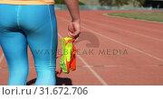 Купить «Mid section of female athlete walking with sport shoes on a running track 4k», видеоролик № 31672706, снято 17 апреля 2018 г. (c) Wavebreak Media / Фотобанк Лори