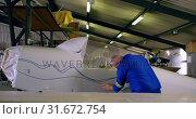 Купить «Engineer marking a line on airplane parts 4k», видеоролик № 31672754, снято 24 февраля 2018 г. (c) Wavebreak Media / Фотобанк Лори