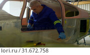 Engineer repairing aircraft in hangar 4k. Стоковое видео, агентство Wavebreak Media / Фотобанк Лори
