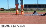Купить «Low section of female athlete exercising on running track 4k», видеоролик № 31672806, снято 17 апреля 2018 г. (c) Wavebreak Media / Фотобанк Лори