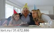 Купить «Multi-generation family celebrating birthday in living room 4k», видеоролик № 31672886, снято 24 августа 2018 г. (c) Wavebreak Media / Фотобанк Лори