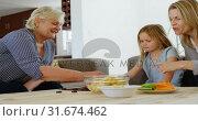 Купить «Multi-generation family toys in living room 4k», видеоролик № 31674462, снято 24 августа 2018 г. (c) Wavebreak Media / Фотобанк Лори