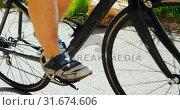 Купить «Senior cyclist cycling on a road at countryside 4k», видеоролик № 31674606, снято 21 августа 2018 г. (c) Wavebreak Media / Фотобанк Лори