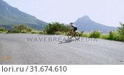 Купить «Senior cyclist cycling on a road 4k», видеоролик № 31674610, снято 21 августа 2018 г. (c) Wavebreak Media / Фотобанк Лори