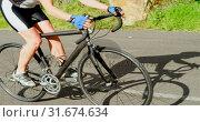 Купить «Senior cyclist cycling on a road 4k», видеоролик № 31674634, снято 21 августа 2018 г. (c) Wavebreak Media / Фотобанк Лори