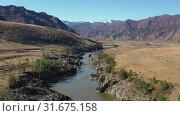 Купить «Aerial video with flight along Katun river with view on Oroktoi bridge and Teldykpen rapids on Altai», видеоролик № 31675158, снято 2 июля 2019 г. (c) Serg Zastavkin / Фотобанк Лори