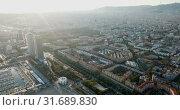 Купить «Aerial view of seaside area of Barcelona with harbor on sunny day, Catalonia, Spain», видеоролик № 31689830, снято 16 ноября 2018 г. (c) Яков Филимонов / Фотобанк Лори