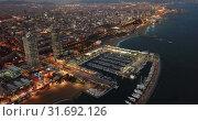 Купить «View from drones of coast in Barcelona and center with building», видеоролик № 31692126, снято 25 декабря 2018 г. (c) Яков Филимонов / Фотобанк Лори