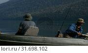 Купить «Fishermen fishing with his dog in the river 4k», видеоролик № 31698102, снято 30 июля 2018 г. (c) Wavebreak Media / Фотобанк Лори