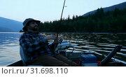 Купить «Fisherman fishing in the river 4k», видеоролик № 31698110, снято 30 июля 2018 г. (c) Wavebreak Media / Фотобанк Лори