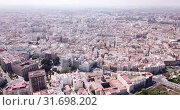 Купить «Aerial view of Valencia cityscape in sunny spring day, Spain», видеоролик № 31698202, снято 16 апреля 2019 г. (c) Яков Филимонов / Фотобанк Лори