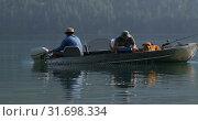 Купить «Two fishermen fishing in the river 4k», видеоролик № 31698334, снято 30 июля 2018 г. (c) Wavebreak Media / Фотобанк Лори